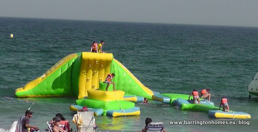 Inflatable in the sea in Sabinillas, Manilva, Costa del Sol