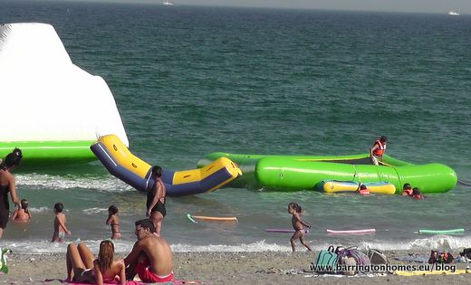 Inflatables in the sea in Sabinillas, Manilva, Costa del Sol, Spain
